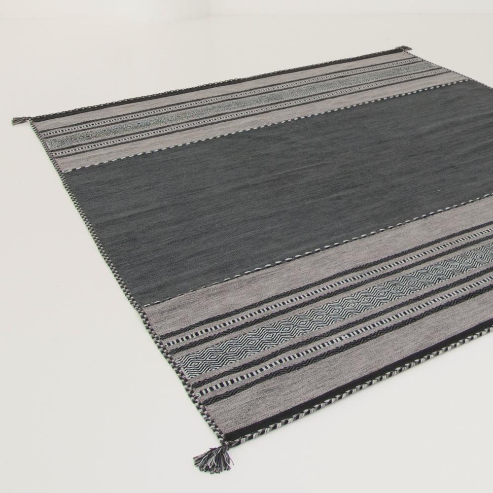 tao modern area rug